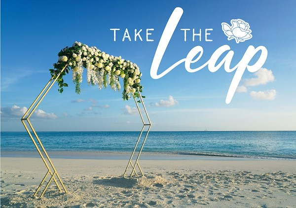 Take the Leap promotional image of a wedding on the beach